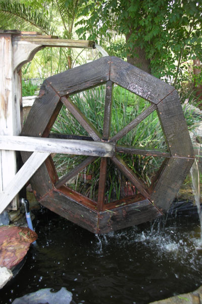 Small ponds and fountains water wheel custom ponds for Pond features and fountains