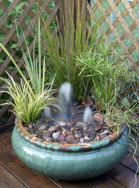 Container fountain small water gardens for Small garden pond with fountain